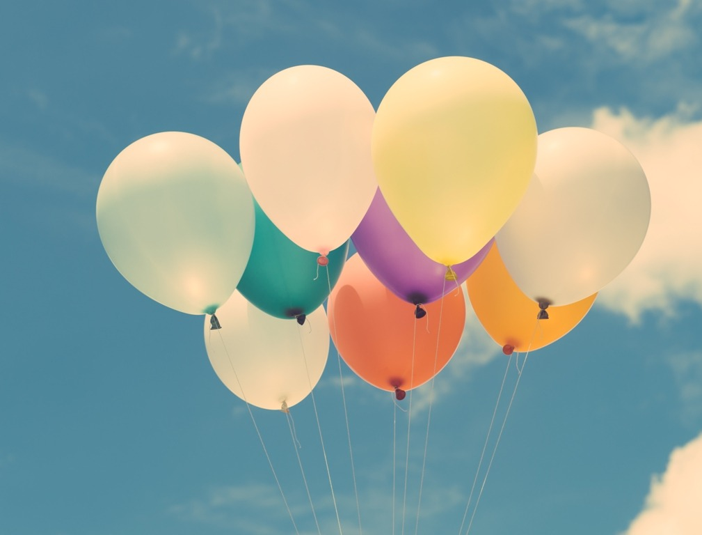 Lots of colorful balloons on the blue sky, concept of love in summer and valentine, wedding honeymoon. Vintage effect style pictures.